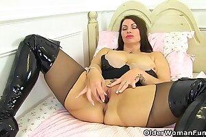 British milf Raven is pleasuring her nyloned pussy