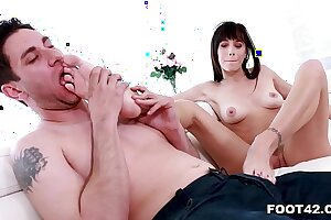 Hot MILF Alana Cruise gives footjob