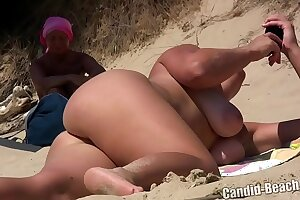 Hot shaved pussy nudist milfs getting tanned naked at the beach